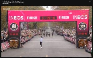 Eliud Kipchoge goes through the finish line in one hour, 59 minutes and 40 seconds.